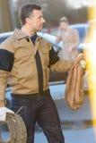 Uniformed man carrying reel hose Stock Image