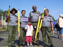 Uniformed veterans of Cuban Literacy campaign and a Cuban pioneer in May Day march. Veterans participants in Cuban Literacy campaign and Cuban pioneer Stock Image