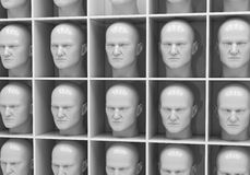 Uniformity. Many of the same people's heads in boxes. Uniformity,  humanity, solitude Royalty Free Stock Photos