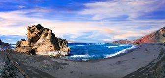 Unika svarta stränder av vulkaniska Lanzarote kanariefågelöar tenerife Royaltyfria Bilder
