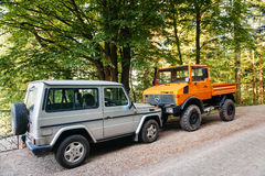 Unimog and Mercedes-Benz G-Class Gelandewagen in front of each o. FRANCE - MAY 10, 2015: Unimog four wheel drive vehicle and Mercedes-Benz G-Class (G-Wagen ( Stock Photography