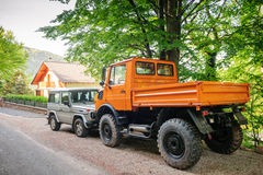 Unimog and Mercedes-Benz G Class SUV. FRANCE - MAY 10, 2015: Rear view of Unimog four wheel drive vehicle and Mercedes-Benz G-Class (G-Wagen (short for Stock Image