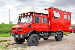 Unimog U4000. NORTH BRABANT, NETHERLANDS - AUGUST 10, 2014: Red off-road motorhome truck Unimog U4000 at the interurban road Stock Photography