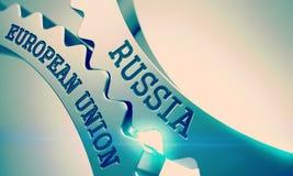 Unión europea de Rusia - texto en mecanismo del metal brillante Cogwhee Foto de archivo libre de regalías