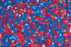 Balloon Background. Image of uninflated red and blue balloons mixed together and flat against a white background royalty free stock photo