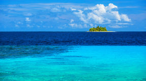 Uninhabited island. In the sea, transparent blue water, virgin wild nature, scenes destination, sunny day, exotic travel and tourism concept Stock Photos