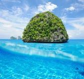 Uninhabited island with white sand bottom Royalty Free Stock Photos