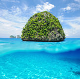 Uninhabited island with white sand bottom underwater view Stock Image