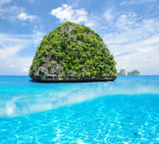 Uninhabited island with white sand bottom underwater view Stock Photography