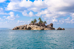 Uninhabited Seychelles island - view from the sea Stock Photos