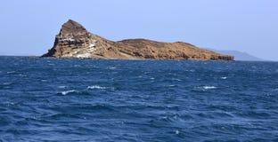 Uninhibited rocky volcanic islet near Hanish island in Red Sea Stock Photos