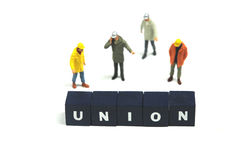 Union. A couple of workmen behind the word union Royalty Free Stock Image