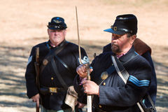 Union Army Civil War Reenactor Demonstrates Bayonet Attachment Stock Images