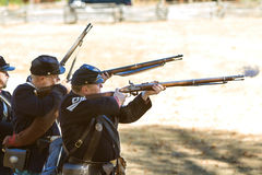 Union Army Civil War Reenactors Shoot Muskets In Firing Demonstration royalty free stock image