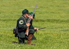 Union Army Sharpshooters of the American Civil War. Re-enactors dressed in the green uniform of United States Sharpshooters are about to engage the enemy during Stock Photo
