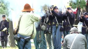Union and Confederate Civil War soldiers in battle. View of Union and Confederate Civil War soldiers in battle stock footage