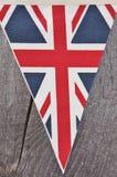 Union flag. Triangular Union flag of United Kingdom (UK) on wooden background Royalty Free Stock Photo
