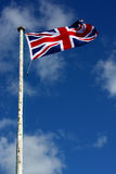Union Flag. On a windy day. This is the flag, generally regarded, to represent the peoples of England, Scotland, Wales and Northern Ireland. The image may show Royalty Free Stock Images