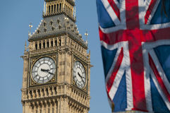 Union Flag and Big Ben. The Union Flag flying in front of the clock tower, commonly referred to as Big Ben, of the Palace of Westminster Stock Photos