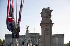 Union Flag with Bucking Palace in the Background. Detail of UK Union flag with Bucking Palace in the background Stock Image