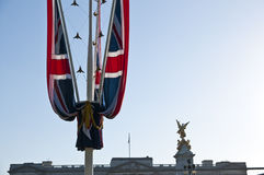 Union Flag with Bucking Palace in the Background. Detail of UK Union flag with Bucking Palace in the background Royalty Free Stock Image