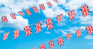 Union Flag Bunting. In blue summer sky Stock Image