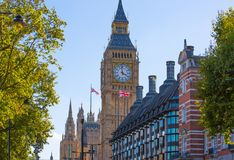The Union Flag flying in front of the clock tower Big Ben, Palace of Westminster. London UK Royalty Free Stock Photo