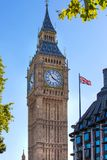 The Union Flag flying in front of the clock tower Big Ben, Palace of Westminster. London UK Royalty Free Stock Photos