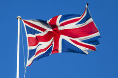 Union Flag Flying. A shot of the Union Flag flying over a clear blue sky Royalty Free Stock Photography