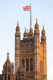 Union Flag flying on Victoria Tower in Westminster. Union Flag flying on top of the Victoria Tower, part of the Palace of Westminster the seat of Government in Stock Images