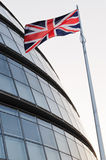 The Union flag and London City Hall Royalty Free Stock Photography