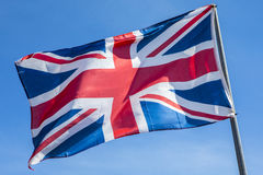 Union Flag over a Clear Blue Sky. A Union Flag flying proudly under a clear blue sky Stock Image