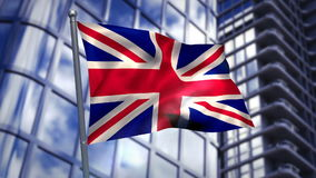 Union flag waving against cityscape. On a sunny day stock video