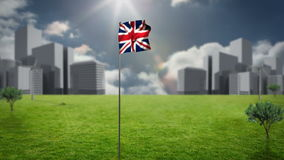 Union flag waving against cityscape. On a sunny day stock video footage