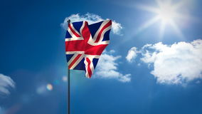 Union flag waving against sky. On a sunny day stock video footage