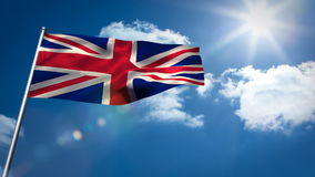 Union flag waving against sky. On a sunny day stock footage