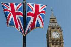 Union Flags and Big Ben. Two Union Flags flying in front of the clock tower, commonly referred to as Big Ben, of the Palace of Westminster Stock Photos