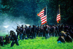 Union infantry line fires on advancing  Confederates Royalty Free Stock Image