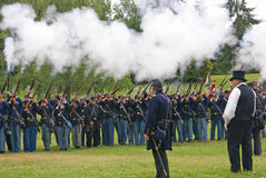 Union infantry line firing a volley. Stock Photos