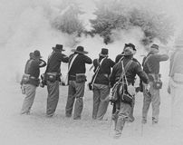 Union infantry line firing a volley. Royalty Free Stock Image