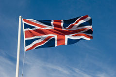 Union Jack. Flying in the sky royalty free stock photography