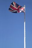 Union Jack. Flying against a blue sky, motion blur on the flag Royalty Free Stock Photography