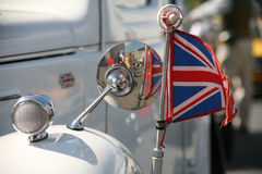 Union Jack. At an old, white vintage car stock photography
