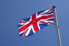 Union Jack against blue sky Stock Image