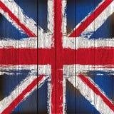 Union Jack auf einem hölzernen Planke-Hintergrund Stockfotografie