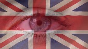 Union-jack and blinking eye. Static British union-jack flag and opening and closing blinking eye stock video