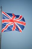 Union Jack - BRITISCHE Flagge im Wind Lizenzfreies Stockfoto