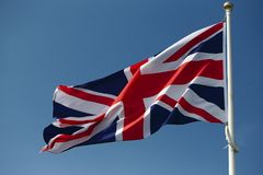 Union Jack British flag flying from a flagpole Royalty Free Stock Photo