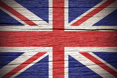 Union Jack. British Union Jack Flag over a Wooden Background royalty free stock photography