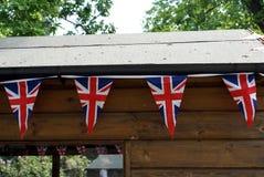 UNION JACK BUNTING TRIANGULAR. flag of UK. Outdoor decoration of Union Jack bunting triangular flags. The flag of the United Kingdom Stock Photo